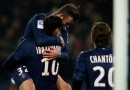 David Beckham of PSG jumps on the goal scorer and team mate Zlatan Ibrahimovic during the Ligue 1 match between Paris Saint-Germain FC and Olympique de Marseille at Parc des Princes on February 24, 2013 in Paris, France.
